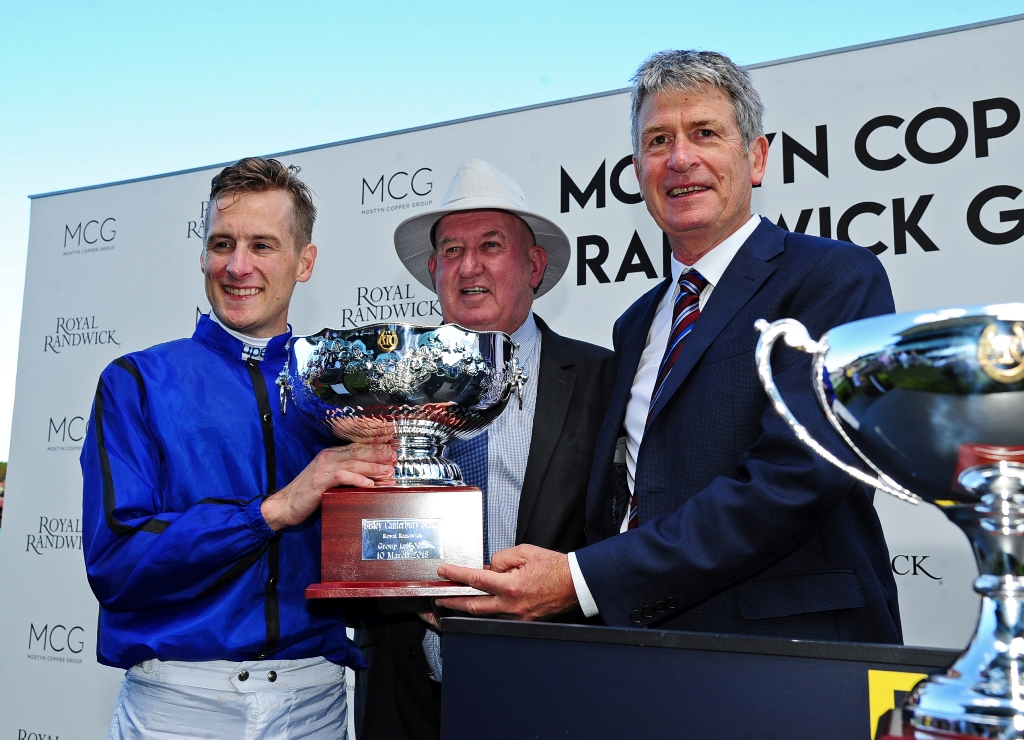 Blake Shinn, Pat Webster and Michael Thomas celebrate Happy Clapper's win the Canterbury Stakes