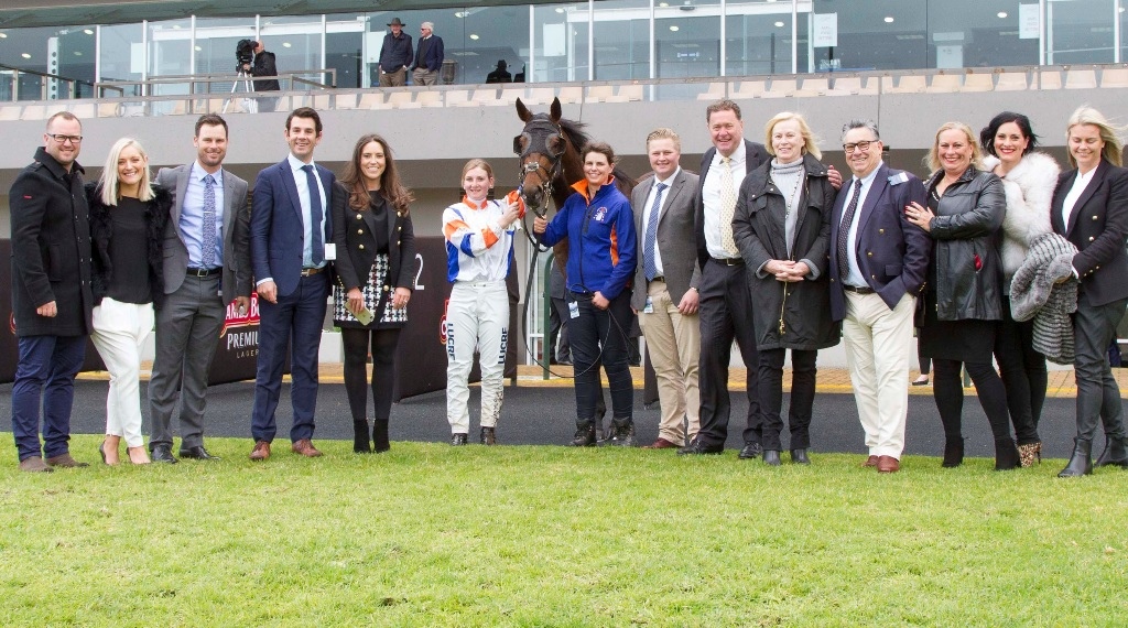 Connections celebrate Just Rolling's win at Morphettville on Saturday