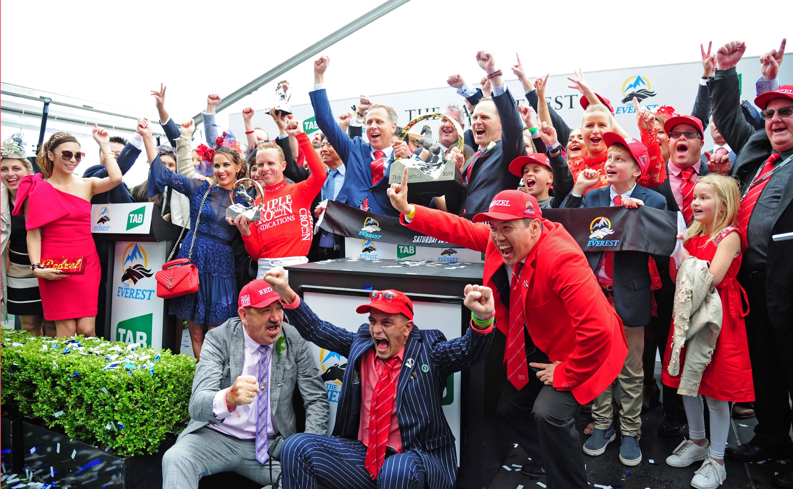 Connections of Redzel celebrate after winning his second Everest